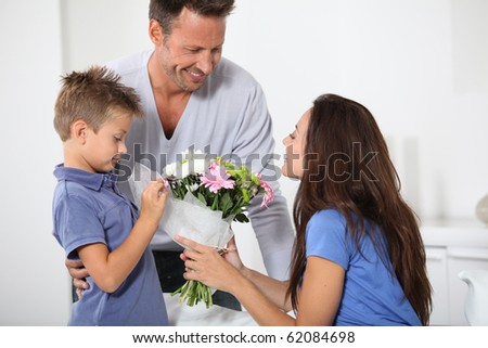 Father and son celebrating mom's birthday - stock photo