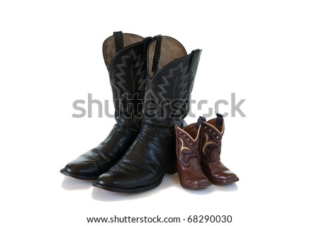 Father and son cowboy boots isolated on white - stock photo