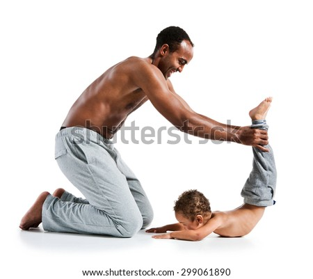 Father and son doing yoga / photo set of sporty muscular Hispanic shirtless fitness man with his son over white background - stock photo