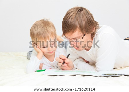 father and son drawing together, family lifestyle