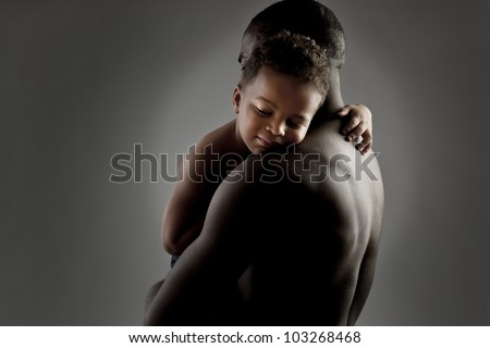 Father and son embracing warmly - stock photo