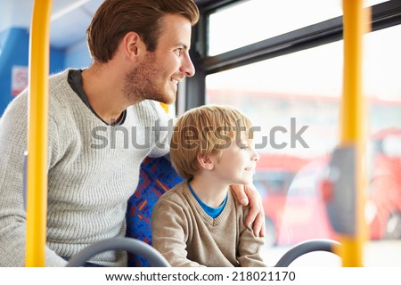 Father And Son Enjoying Bus Journey Together - stock photo