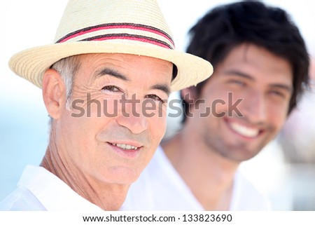 Father and son enjoying each other's company on a sunny summer's day - stock photo