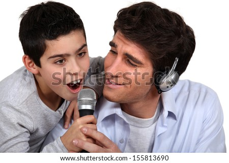father and son enjoying music together - stock photo