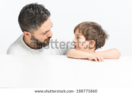 Father and son expressing argument and discipline - stock photo
