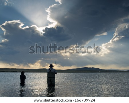 Father and son fishing at Eleven Mile Reservoir, Colorado. - stock photo
