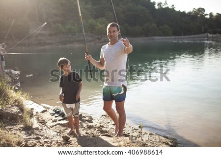 Father and son fishing. Caught fish - stock photo