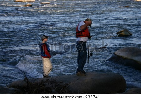 Father and Son Fishing in the James River - stock photo