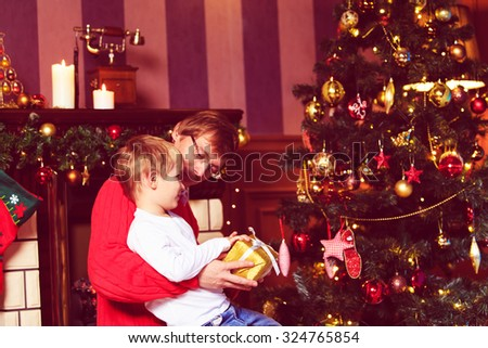 father and son giving presents in Christmas home - stock photo