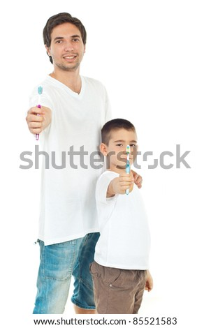 Father and son giving toothbrushes isolated on white background - stock photo
