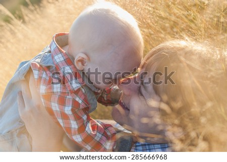 Father and son go for a walk - stock photo