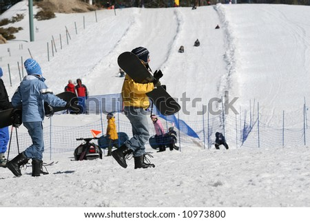 Father and son going to snowboarding. - stock photo