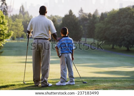 Father and Son Golfing - stock photo