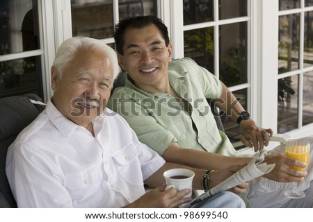 Father and Son Having Breakfast Together - stock photo