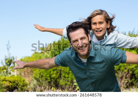Father and son having fun in the countryside - stock photo