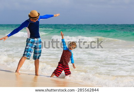 father and son having fun on summer sea vacation