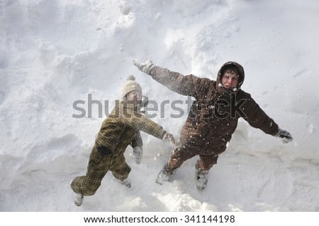 Father and son having fun outdoors on winter holidays - stock photo