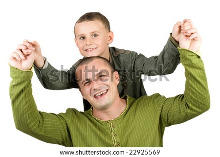 Father and son having fun, over white background