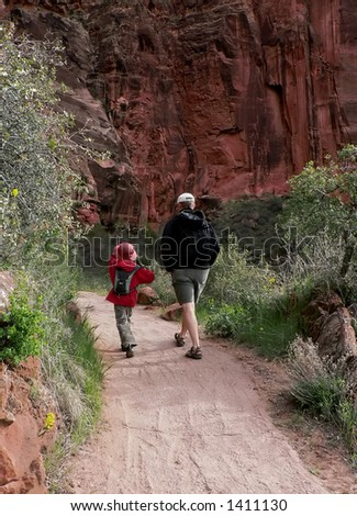 Father and son hiking - stock photo