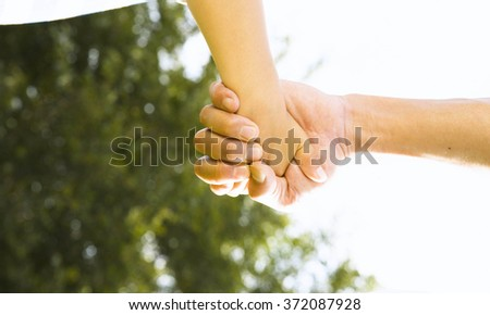 Father and son holding hand  - stock photo