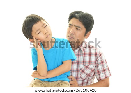 Father and son in a fight - stock photo