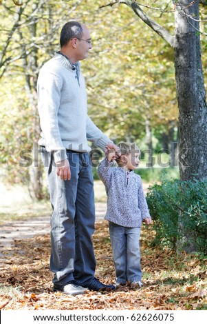 father and son in autumn park