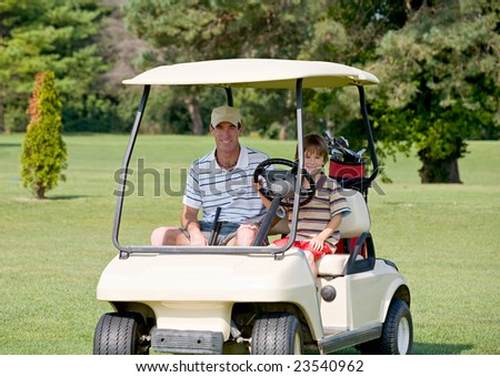 Father and Son in Golf Cart