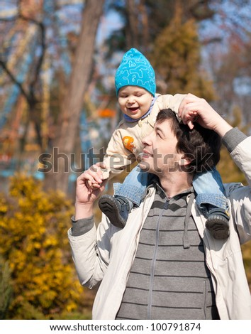 Father and son in spring park - stock photo
