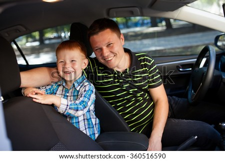 Father and son in the car.