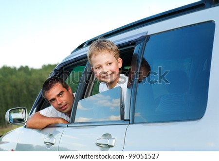 father and son in  the car