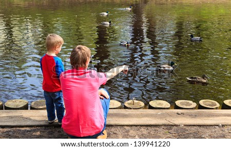 father and son in the park - stock photo