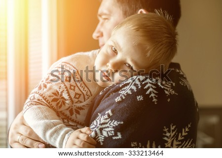 Father and son.Indoor near the window. - stock photo