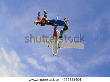 Father and son jumping from a plane. Skydiving - stock photo