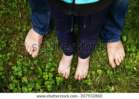 father and son legs, small and big          - stock photo