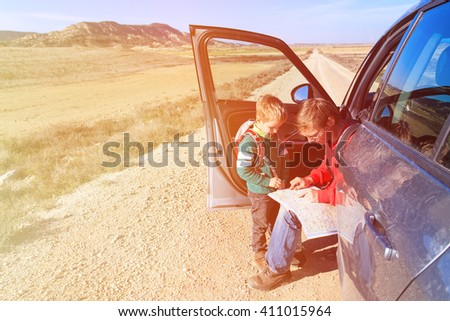 father and son looking at map while travel by car - stock photo