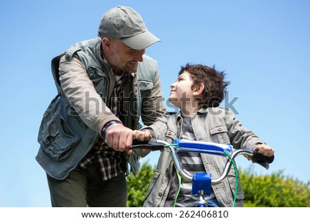 Father and son on a bike ride in the countryside - stock photo