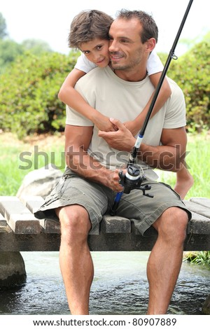 Father and son on a fishing trip - stock photo