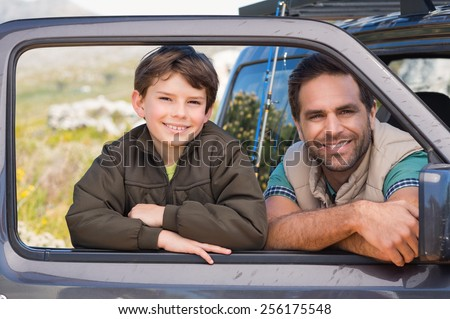 Father and son on a road trip on a sunny day - stock photo