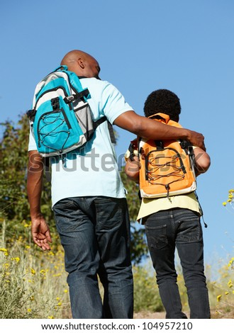 Father and son on country hike - stock photo