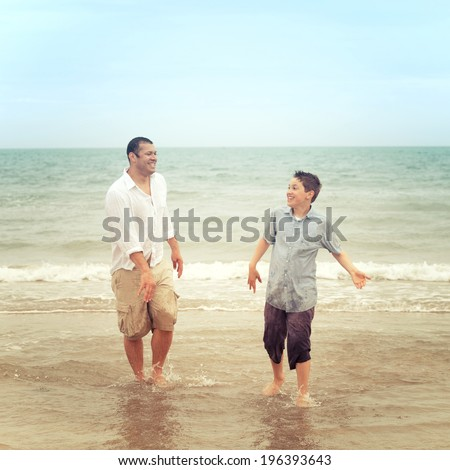 Father and son on the beach having a conversation