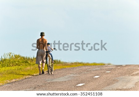 father and son on the road - stock photo