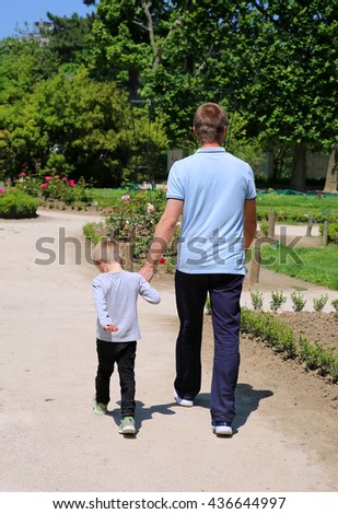 Father and son on the walk in the park