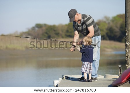 father and son or grandfather and grandson fishing - stock photo
