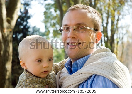 Father and son outdoor autumn