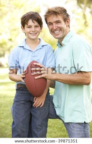 Father And Son Playing American Football Together - stock photo