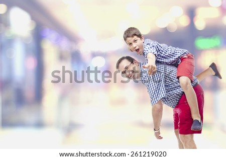 Father and son playing in shopping center - stock photo