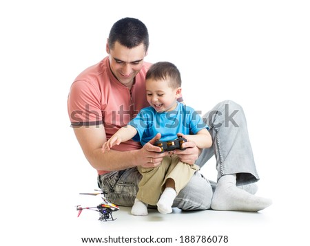 Father and son playing kids helicopter game - stock photo