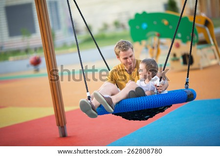 Father and son playing outdoors - stock photo