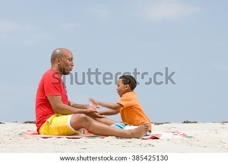 Father and son playing patacake - stock photo