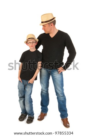 Father and son posing with straw hats in studio - stock photo